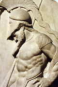 Greek warrior. Hellenistic, 1st century BC From Rhodes This marble grave relief shoes a warrior dressed in a cuirass and helmet leaning on his spear in front of a funerary stele. The serpent at the base symbolises the soul of the deceased. The relief is 'archaising' and imitates Greek sculpture of the mid 5th century BC.