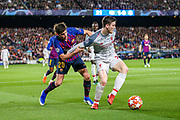 Barcelona defender Sergi Roberto (20) holds back Liverpool defender Andy Robertson (26) during the Champions League semi-final leg 1 of 2 match between Barcelona and Liverpool at Camp Nou, Barcelona, Spain on 1 May 2019.