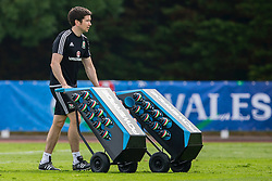 DINARD, FRANCE - Thursday, June 9, 2016: Wales' Dr Rhodri Martin wheels on two Powerade drinks dispensers during a training session at their base in Dinard during the UEFA Euro 2016 Championship. (Pic by Paul Greenwood/Propaganda)