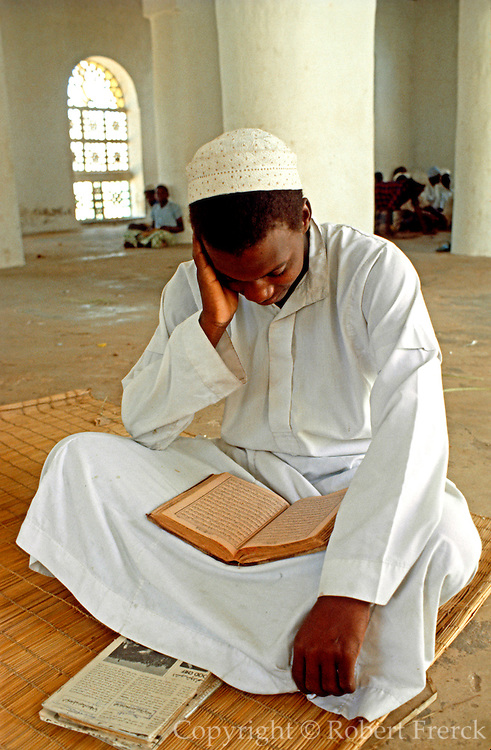 KENYA, LAMU ISLAND Swahili teenager studys Koran in Madrasa