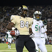 UCF Knights tight end Justin Tukes (84) celebrates a touchdown reception near the end of the 2nd quarter of the NCAA football game between the South Florida Bulls and the 17th ranked University of Central Florida Knights at Bright House Networks Stadium on Friday, November 29, 2013 in Orlando, Florida. (AP Photo/Alex Menendez)