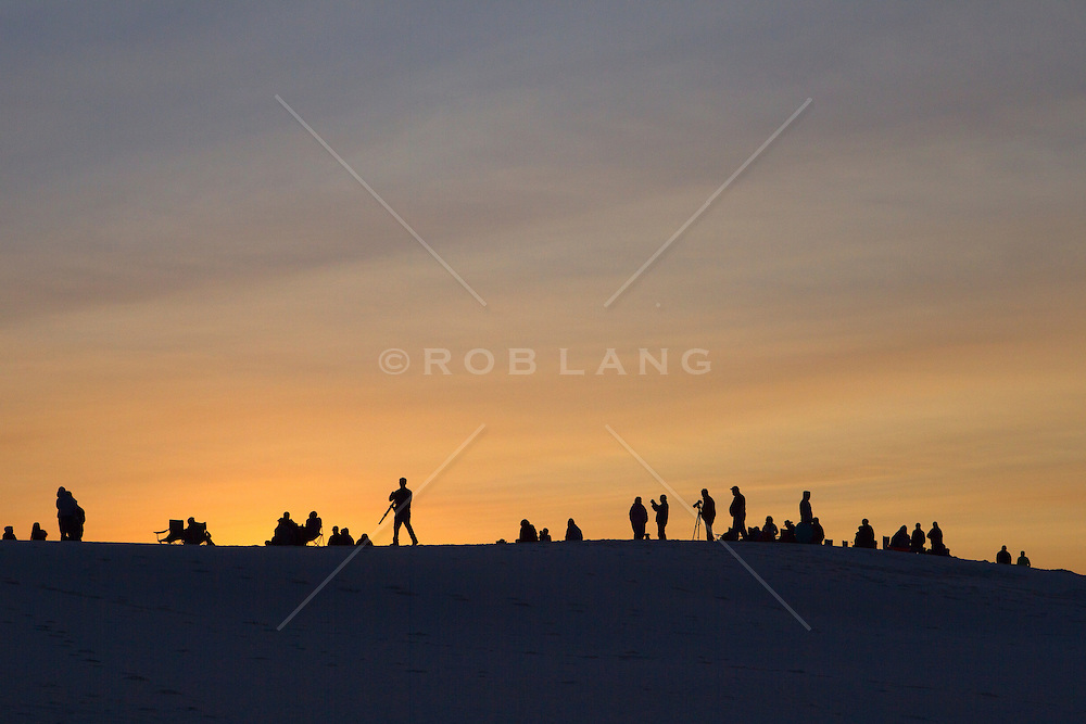 crowd gathering to watch the sunrise in White Sands, New Mexico