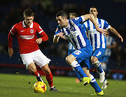 Brighton player Jamie Murphy gets the better of Charlton Athletic midfielder Johann Berg Gudmundsson during the Sky Bet Championship match between Brighton and Hove Albion and Charlton Athletic at the American Express Community Stadium, Brighton and Hove, England on 5 December 2015. Photo by Bennett Dean.