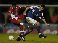 Photo: Jonathan Butler.<br /> <br /> Swindon Town v Carlisle United. The FA Cup. 11/11/2006.<br /> <br /> Jerel Ifil of Swindon has his shorts tugged by Derek Holmes of Carlisle.