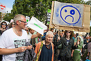 "People's Climate march, London – As part of an international day of protest - led by Emma Thompson and Vivienne Westwood  (pictured in orange cardigan)- people march to demand: ""a world with an economy that works for people and the planet; a world safe from the ravages of climate change; and a world with good jobs, clean air, and healthy communities for everyone.  The march started in Temple Place and ended outside Parliament – Westminster, London, UK,  21st Sept  2014. Guy Bell, 07771 786236, guy@gbphotos.com"