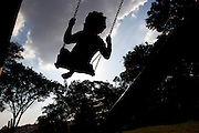 Betim_MG, Brasil.<br /> <br /> Silhueta de uma crianca brincando no balanco em no Projeto Escola da Gente em Betim, Minas Gerais.<br /> <br /> Silhouette of a child playing on the swing  in Escola da Gente Project in Betim, Minas Gerais.<br /> <br /> Foto: MARCUS DESIMONI / NITRO