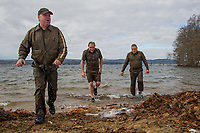 Team UPS (Scott Emerson, Jim Gentile and Mark Emery) continued on the tradition (14 years) of the Turkey Plunge at Bartlett Beach on Saturday morning.  (Karen Bobotas/for the Laconia Daily Sun)