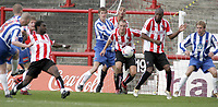 Michael Nelson (5, left) equalises forHartlepool