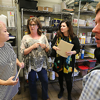 Park Heights owner Blair Hughes, center left, gives a tour of the restaurants kitchen to this year's celebrity chefs Leslie Geoghegan, from left, Elizabeth Hamm and Ruff Thomas as they prepare to raise money for the Boys & Birls Club of North Mississippi.