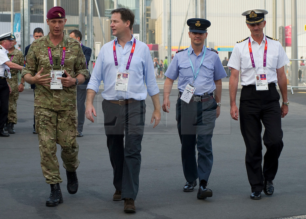 © Licensed to London News Pictures. 09/08/2012. London, UK. Deputy Prime Minister, Nick Clegg, meeting British troops on security duties at the Olympic Park in Stratford, East London on August 9, 2012  escorted during his visit by Colonel Gary Wilkinson (pictured left) to hear about their work and thank them in person for all their efforts to help make the Olympics such a success. Photo Credit: Corporal Mark Larner/LNP