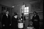 President Eamon de Valera and An Taoiseach Seán Lemass cast their votes in the General Election.  Picture shows Mrs. de Valera voting at Phoenix Park Schools, Dublin, watched by her husband.  <br /> 07.04.1965