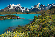 Patagonia, Chile, February 2016. Lago Pehoe offers the classic look of the Torres del Paine National Park. Torres del Paine is a UNESCO World Biosphere Reserve and encompasses mountains, glaciers, lakes, and rivers in southern Chilean Patagonia. The Cordillera del Paine is the centerpiece of the park. It lies in a transition area between the Magellanic subpolar forests and the Patagonian Steppes. A 4x4 camper is one of the best vehicles to explore the wild interior of Southern Patagonia. Photo by Frits Meyst / MeystPhoto.com