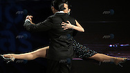 The Argentine couple of Hebe Lucia Hernandez (back) and Fernando Ariel Carrasco dance during the semifinal round of the Stage Tango competition at the Tango Dance World Championship in Buenos Aires on August 25, 2012.   AFP PHOTO / Alejandro PAGNI