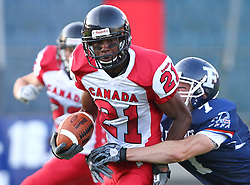 09.07.2011, UPC Arena, Graz, AUT, American Football WM 2011, Group B, France (FRA) vs Canada (CAN), im Bild Aurélien Fourgeaud (France, #7, DB ) tackles Troy Adams (Canada, #21, DB)  // during the American Football World Championship 2011 Group B game, France vs Canada, at UPC Arena, Graz, 2011-07-09, EXPA Pictures © 2011, PhotoCredit: EXPA/ T. Haumer