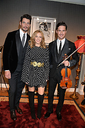 Left to right, DAVID GANDY, KYLIE MINOGUE and English contemporary classical violinist CHARLIE SIEM at the Dolce & Gabbana London Collections: Mens Event 2014 held at Dolce & Gabbana, 53-55 New Bond Street, London on 5th January 2014.