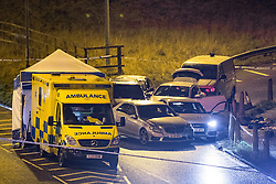 © Licensed to London News Pictures. 03/01/2017. Huddersfield, UK. The scene of a bullet riddled white Audi car at the slip road at Junction 24 of the M62 motorway in Huddersfield . West Yorkshire police have announced a man has died following the discharge of a police firearm , during what they describe as a pre-planned operation , yesterday evening (2nd January 2017) . Photo credit : Joel Goodman/LNP