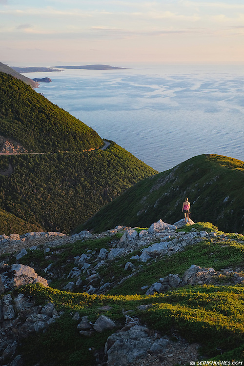 A woman enjoys the view from the Skyline Trail at Cape Breton Highlands National Park, Nova Scotia, Canada.
