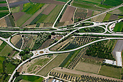 Overpasses and traffic circles amdist vineyards in Italy