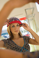 Young Woman Trying on Hat