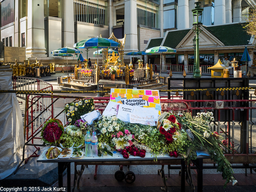 19 AUGUST 2015 - BANGKOK, THAILAND: A memorial in front of the Erawan Shrine on the first day that the Erawan Shrine reopened in Bangkok. Erawan Shrine in Bangkok reopened Wednesday morning after more than 20 people were killed and more than 100 injured in a bombing at the shrine Monday, August 17, 2015. The shrine is a popular tourist attraction in the center of Bangkok's high end shopping district and is an important religious site for Thais. No one has claimed responsibility for the bombing.        PHOTO BY JACK KURTZ