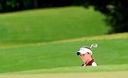 Hartselle golfer Heather Nail shows a determined face as she stands over a shot in a sand trap during the final round of the State Golf Tournament Tuesday at Hampton Cove in Huntsville.  Photo by Gary Cosby Jr.  05/11/10