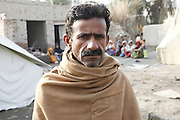 Punhal, aged 42, from a village near Jacobabad in Pakistan's Sindh province, says, &quot;Before the flood, we were doing ok. We were cultivating wheat and rice, and were able to produce enough to sell some and store enough for the year&quot;<br /> <br /> &quot;The water came suddenly without warning. We used to have good houses here, but they were washed away. Now we are living in tents. We tried to save our animals, but we had to sell them to pay for transport to get to safety in Quetta.&quot;<br /> <br /> &quot;When we first came back to the village after two months away, there was no clean water, so people were getting sick. Now that we have clean water again thanks to Mercy Corps, it is much better.&quot;<br /> <br /> &quot;When returned, we had no means to make any money. Until the stagnant water drains away, we can't plant seed again. I'm hoping to get some work on a cash-for-work scheme, so that we can buy some seed.&quot;<br /> <br /> UKaid funding from the British government's Department for International Development is helping the NGO Mercy Corps deliver clean water and sanitation facilities to over 160,000 people in Sindh, as they return home to destroyed houses and partially flooded communities and agricultural land.<br /> <br /> In some parts of Sindh the water may take many months more to fully drain away, despite the flooding originally occuring in August and September 2010. More than 20 million people were affected across Pakistan, making the flooding possibly the single biggest humanitarian crisis the world has ever seen.<br /> <br /> Find out more about the UK government's response to the Pakistan floods at www.dfid.gov.uk/pakistan-floods-six-months ( http://www.dfid.gov.uk/pakistan-floods-six-months ) <br /> <br /> Image: Department for International Development/Russell Watkins<br /> <br /> Terms of use<br /> <br /> This image is posted under a Creative Commons - Attribution Licence ( http://creativecommons.org/licenses/by/3.0/ ) , in accordance with the Open Government Licence ( http://www.nationalarchives.gov.uk/doc/open-government-licence/ ) . You are free to embed, download or otherwise r