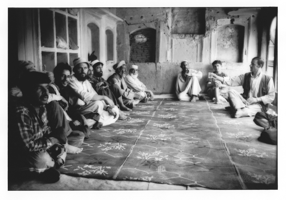 Workers for the Turquoise Mountain Foundation meet in peacock room, under restoration, to discuss restoration efforts in the Murad Khane neighborhood of Kabul, Afghanistan.  Turquoise Mountain Foundation, a non-profit organization, employs local men to help restore this neighborhood in the old city of Kabul.