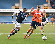 Millwall midfielder Mahlon Romeo takes on Blackpool defender Will Aimson during the Sky Bet League 1 match between Millwall and Blackpool at The Den, London, England on 5 March 2016. Photo by David Charbit.