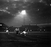 19/09/1962<br /> 09/19/1962<br /> 19 September 1962<br /> Soccer: Sporting Clube de Portugal (Sporting Lisbon) v Shelbourne, European Cup, at Dalymount Park. The game ended 2-0 to Sporting. Heavey in danger as full back Tommy Carroll passes back under pressure.