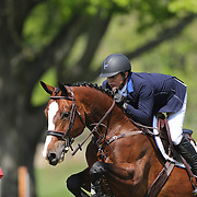 Alvaro Tejada riding Voltaral Palo Blanso in action during the $100,000 Empire State Grand Prix presented by the Kincade Group during the Old Salem Farm Spring Horse Show, North Salem, New York,  USA. 17th May 2015. Photo Tim Clayton