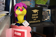 """A """"Keep Calm and Graduate"""" sign sits behind coach Krystal Morrows desk at Bryan Adams High School on March 24, 2016 in Dallas, Texas. (Cooper Neill for The Texas Tribune)"""