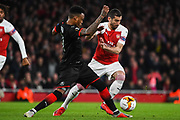 Rennes Mexer (4) and Arsenal Midfilder Henrikh Mkhitaryan (7) battle for the ball during the Europa League round of 16, leg 2 of 2 match between Arsenal and Rennes at the Emirates Stadium, London, England on 14 March 2019.