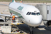 Alitalia, Passenger plane on the ground at at Linate airport, Milan, Italy. Ground crew are approaching the plane