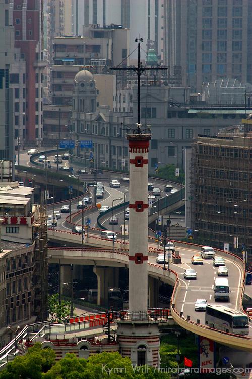Asia, China; Shanghai. Traffic on mutiple levels of freeways meander through Shanghai.
