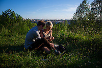Vilnius, Lithuania- June, 2015: A couple enjoys a quiet moment as sun sets over the old town of Vilnius, which was recognized as an UNESCO World Heritage site in 1994. While much of the surrounding area still bears the marks of the Soviet days, the old town offers vibrant new offerings on a backdrop of Gothic, Renaissance, Baroque and classical architecture. CREDIT: Chris Carmichael for The New York Times