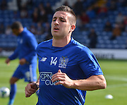 Bury Defender Craig Jones warms up before the Sky Bet League 1 match between Bury and Coventry City at Gigg Lane, Bury, England on 26 September 2015. Photo by Mark Pollitt.