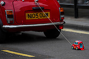 The London and Surrey Mini Owners Club - The New Years Day parade passes through central London.