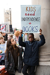 "July 24, 2017 - London, London, UK - LONDON, UK. Primary school children from Barnet take part in a ""Don't lock us out of our library"" protest outside the offices of the Department for Culture, Media and Sport in Westminster, delivering 440 postcards addressed to Karen Bradley, the Culture Secretary, demanding a reinstatement of independent access to libraries. Public libraries in Barnet have been shut and are now reopening with restricted access and opening hours, making the service less accessible to vulnerable members of the community. (Credit Image: © Vickie Flores/London News Pictures via ZUMA Wire)"