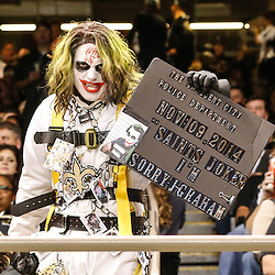 Nov 16, 2014; New Orleans, LA, USA; New Orleans Saints fan Scott McGowan who dresses as the Joker holds up a sign for New Orleans Saints tight end Jimmy Graham (not pictured) during the second half of a game against the Cincinnati Bengals at the Mercedes-Benz Superdome. The Bengals defeated the Saints 27-10. Mandatory Credit: Derick E. Hingle-USA TODAY Sports