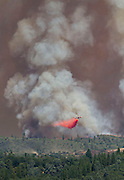 August 22, 2013<br /> An air crane (helicopter) releases fire retardant near Pine Mountain Lake as the Rim Fire encroaches the Groveland, California, on Thursday, August 22, 2013.