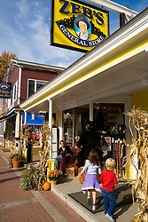 A young girl (age 6) and boy (age 4) play outside Zeb's Country Store in North Conway, New Hampshire.