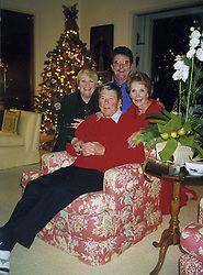 Aug 13, 2001; Los Angeles, CA, USA;  File Photo: Dec, 1998. This photo shows former President RONALD REAGAN with his wife, NANCY, right, daughter MAUREEN REAGAN, and her husband, DENNIS REVELL, at the Reagan's Bel Air Estates home in Los Angeles during Christmas 1998. Maureen, daughter of actress Jane Wyman and President Reagan, who became a crusader for Alzheimer's disease awareness, died of cancer Wednesday, Aug. 8, 2001.   (Credit Image: © Reagan Foundation/ZUMAPRESS.com)
