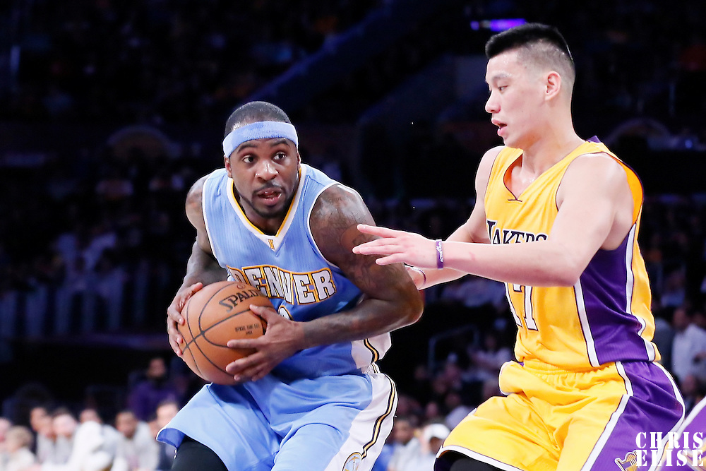 10 February 2015: Denver Nuggets guard Ty Lawson (3) drives past Los Angeles Lakers guard Jeremy Lin (17) during the Denver Nuggets 106-96 victory over the Los Angeles Lakers, at the Staples Center, Los Angeles, California, USA.