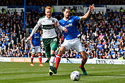 Ryan Taylor (19) of Plymouth Argyle battles for possession with Christian Burgess (6) of Portsmouth during the EFL Sky Bet League 2 match between Portsmouth and Plymouth Argyle at Fratton Park, Portsmouth, England on 14 April 2017. Photo by Graham Hunt.