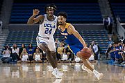 San Jose State Spartans guard Zach Chappell (4) drives past UCLA Bruins forward Jalen Hill (24) during an NCAA college basketball game, Sunday, Dec. 1, 2019, in Los Angeles. UCLA defeated San Jose State 93-64. (Jon Endow/Image of Sport)
