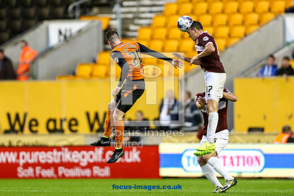 Gregor Robertson of Northampton Town (right) heads clear during the Capital One Cup match at Molineux, Wolverhampton<br /> Picture by Andy Kearns/Focus Images Ltd 0781 864 4264<br /> 12/08/2014