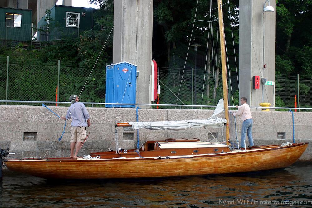 Europe, Sweden, Stockholm. A boat docked along a canal of Stockholm.