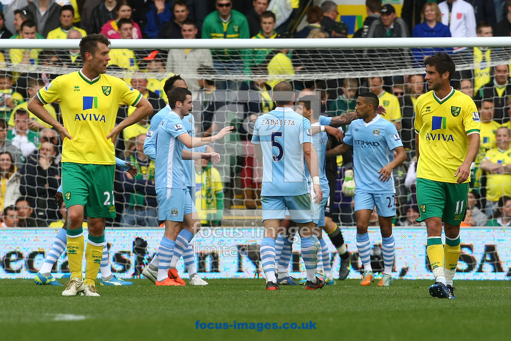 Picture by Paul Chesterton/Focus Images Ltd.  07904 640267.14/04/12.Adam Johnson of Man City scores his sides 6th goal and celebrates during the Barclays Premier League match at Carrow Road Stadium, Norwich.