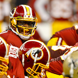 September 9, 2012; New Orleans, LA, USA; Washington Redskins quarterback Robert Griffin III (10) against the New Orleans Saints during the second half of a game at the Mercedes-Benz Superdome. The Redskins defeated the Saints 40-32. Mandatory Credit: Derick E. Hingle-US PRESSWIRE