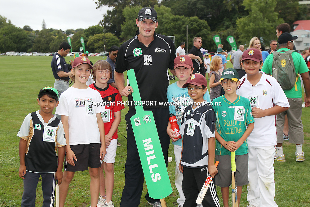 Kyle Mills poses for a photo with young fans at the National Bank's National Cricket Club ( NCC ) Supercamp, Parnell Cricket Club, Auckland, Friday 4 February 2011. Photo: Andrew Cornaga/photosport.co.nz